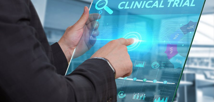 concept image of a doctor selecting a clinical trial from a tablet device