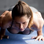 athletic woman doing push ups