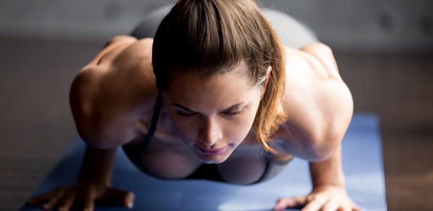 athletic woman doing push ups
