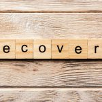 lettered tiles spelling out recovery