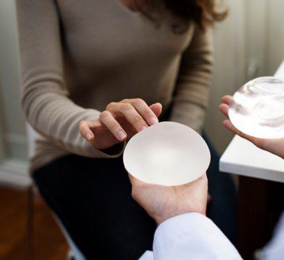 female patient choosing between breast implant types