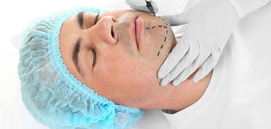 male chin surgery patient getting prepped for treatment