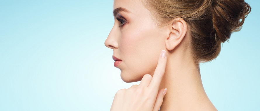 female model pointing at her earlobe