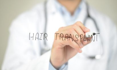 concept of a male doctor writing hair transplant on screen