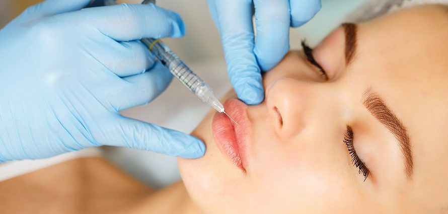 young female patient getting lip injections