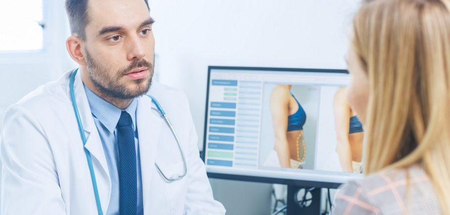 plastic surgeon discusses treatment with a patient