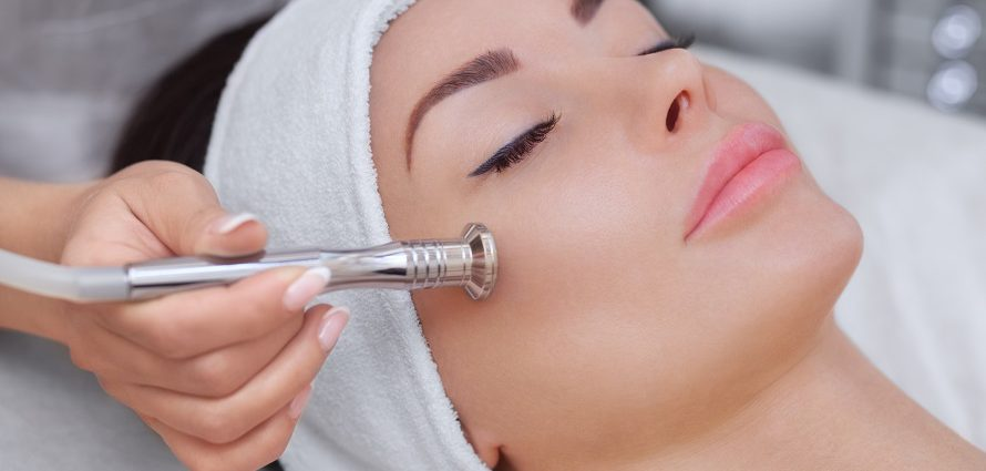 female patient receiving microdermabrasion treatment
