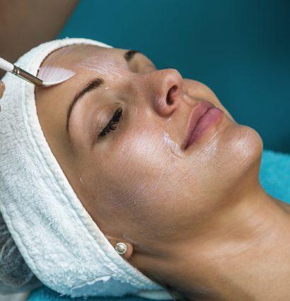 female patient receiving a chemical peel facial