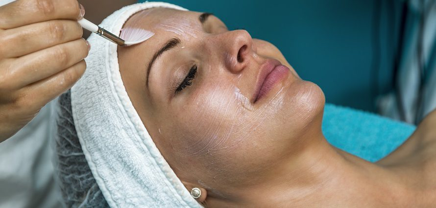 female patient receiving a chemical peel facial