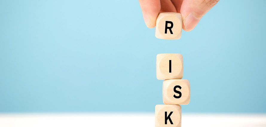 stacking lettered dice to spell risk